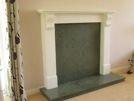 Modern plaster fireplace surround with green marble hearth and back, very good condition