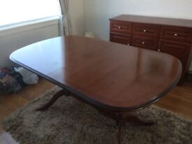Dark wood mahogany dinning table and chairs ,very good condition hardly used