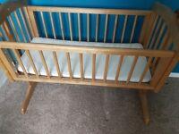 Swinging wooden crib