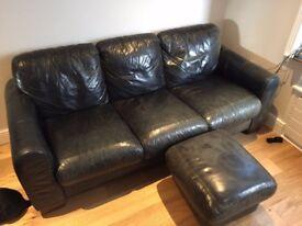 Large lack leather sofa