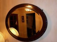 Antique oval mahogany mirror