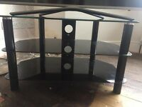 Black & chrome, excellent condition, 2 shelves for sky box/DVD player etc. 48cm high x 80cm wide