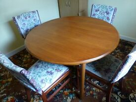 Lovely real wood round/oval extendable dining table and 4 chairs