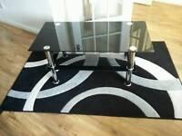 Black glass coffee table and rug