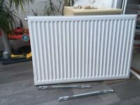 2 central heating radiators: 90 x 60cms and 110 x 60cms including mounting brackets
