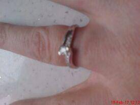9ct white gold/ diamond twist design ring.