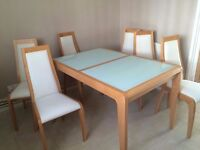 Solid wood extendable with 6 chairs.