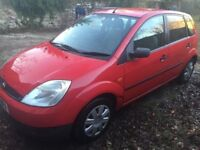 2003 Ford Finesse low miles 1.25 5D Red