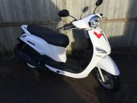 Low mileage, Yamaha scooter for sale. one owner from new.
