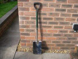 A garden spade in good condition.