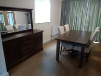 DINING TABLE (DARK WOOD) SEATS 8 & 4 UPHOLSTERED CHAIRS, SIDEBOARD & FRAMED MIRROR. ALL SOLID WOOD