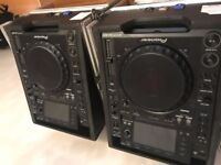 A pair of CDJ-2000's for sale with flight cases
