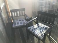 2 x black outside chairs with cushions