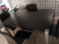 Black High gloss dining table and four chairs