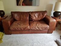 a 3 seater brown leather sofa