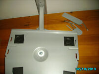 T.V wall mounted stand silver