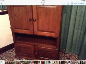 Beautiful medium oak cabinet, many uses, drinks, TV, books, CD's videos