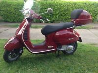 Immaculate Vespa GTS 250 Cherry Red with Visor, Top Box and manual