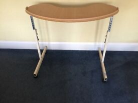 Kidney shaped over chair table