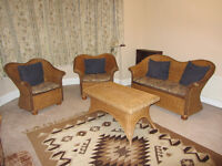 Set of wicker furniture - 2 arm chairs, a sofa and table