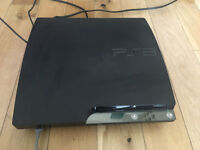 Playstation 3 (PS3 slim), 2 controllers, USB controller charger, 3 games