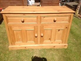 Solid Pine cabinet with 2 drawers and a double cupboard underneath with a full length shelf.