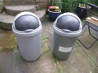 Two grey rubbish bins