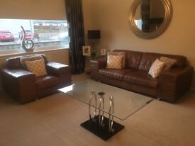 Tan leather suite ( 3 seater & 2 chairs) excellent condition
