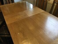 Dining table six chairs table has marks and chairs have marked seat due to cats