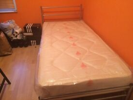 Brand new single bed with un-used mattress