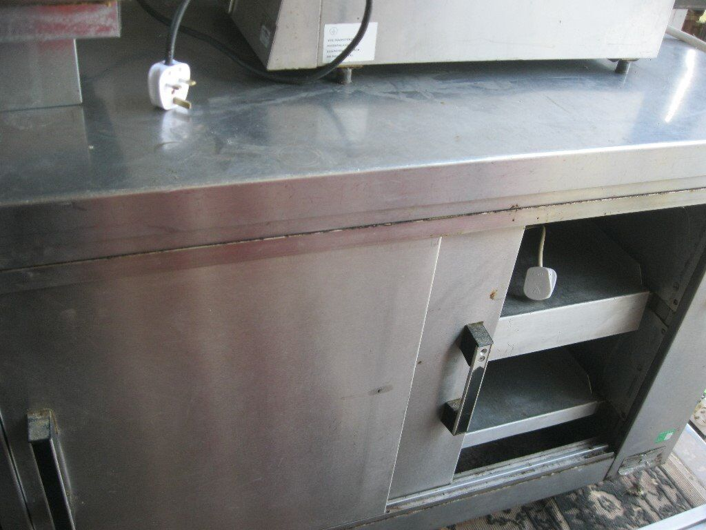 COMMERCIAL STAINLESS STEEL 'DANE' DOUBLE SIDED ELECTRIC HEATED CABINET/WORKTOP. VIEWING/DELIVERY