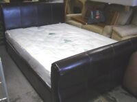 Double Sleigh Bed in Dark Brown Faux Leather. Good Condition