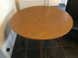 Round Light Oak Extendable Dining Table