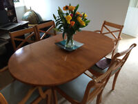 Dining table, 6 chairs and glass door dresser in attractive yew wood. Good condition