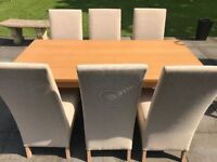 A smart looking solid wood (oak/beech not sure) Dining table & 6 comfy cream fabric sturdy chairs.