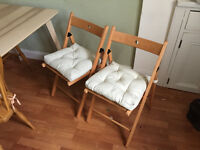 Two folding dining chairs