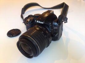 Nikon D3100 Digital Camera + lens, charger & accessories
