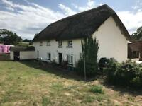 Double bedroom in thatched cottage on a working farm