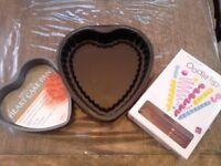 2 heart shaped baking tins and food filling and decorating bags