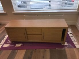 Next Oak TV unit. Like new condition. Has 2 x cupboards and 2 x drawers for storage within