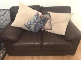 2 seater leather sofa like new.