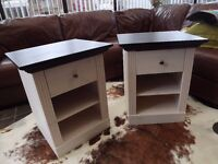 two wooden bedside cabinets.