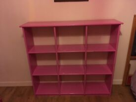 Pink wooden shelving unit