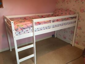 White mid sleeper bed and mattress