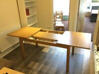 Extendable dining table with 6 blue chairs