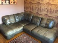 Leather corner sofa in distressed effect grey.