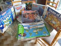 seven board games with original boxes,whole family & children can play,all for only £15. v/nice.
