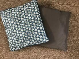 Two large cushions