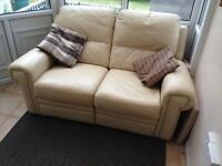 2 seater leather sofa and matching single arm chair.
