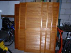 Louvred wooden cupboard doors
